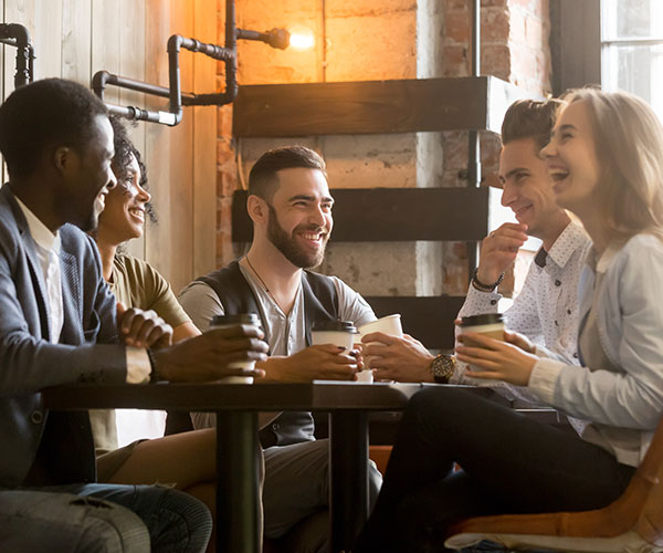 Group of people enjoying coffee at a table